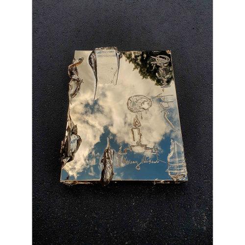 Necessary Illusion   Writing on the artwork: Anarhiofobia. Necessary Illusion.  Perfect $ystem  Colour:Gold 61 x 46 x 7cm  Sterling Silver, Aluminium, Polyester
